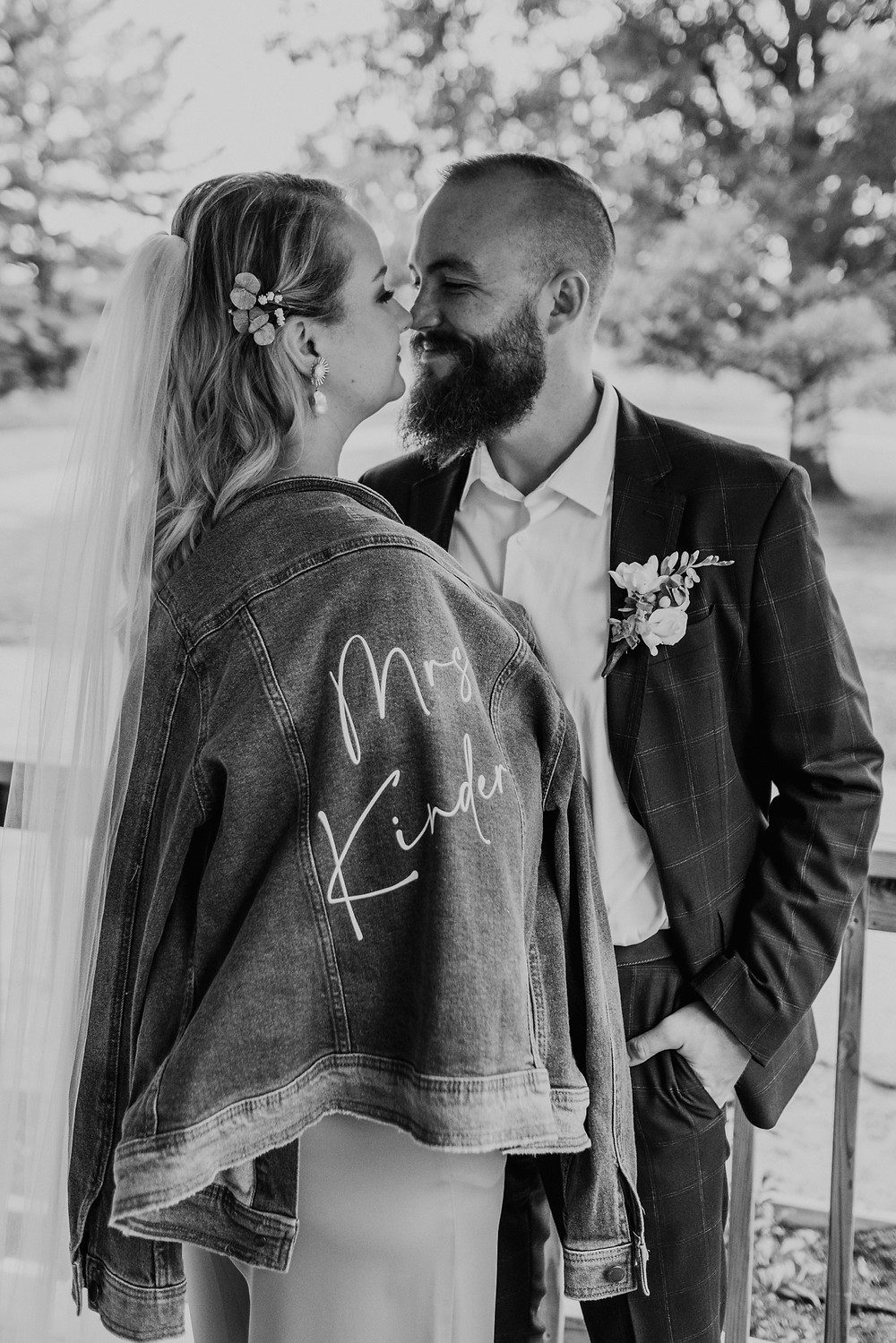 Black and white wedding portrait of bride and groom. Photographed by Nicole Leanne Photography.