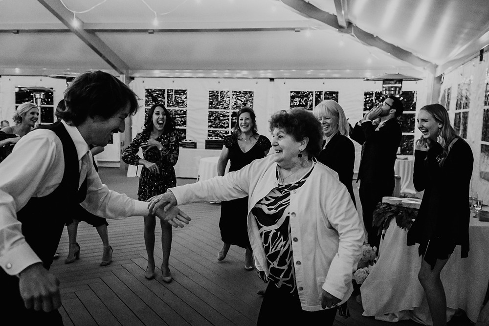 Family and guests dancing at wedding. Photographed by Nicole Leanne Photography.