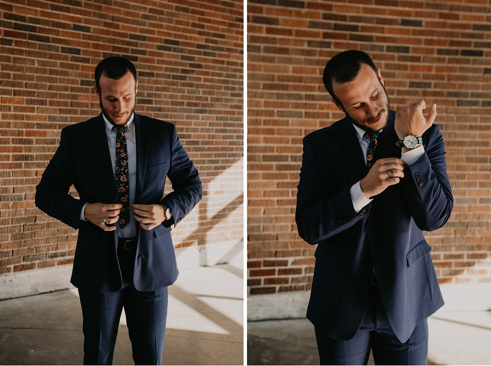 Groom getting ready for wedding in suit. Photographed by Nicole Leanne Photography.