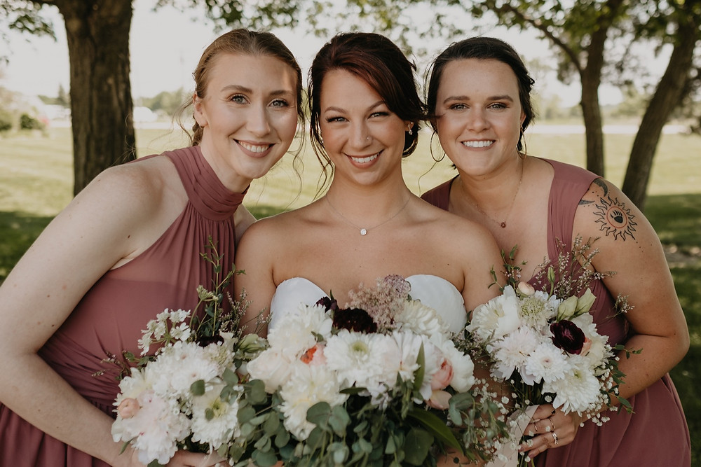 Bride with bridal party at wedding. Photographed by Nicole Leanne Photography.