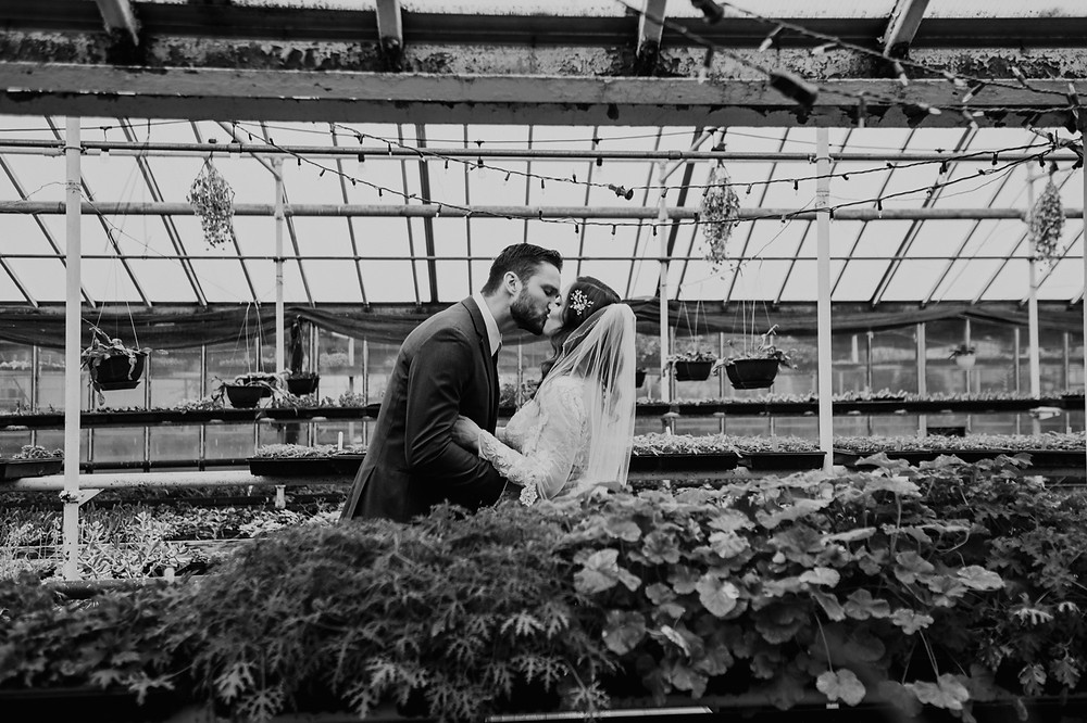 Greenhouse wedding photo of Bride and Groom. Photographed by Nicole Leanne Photography.