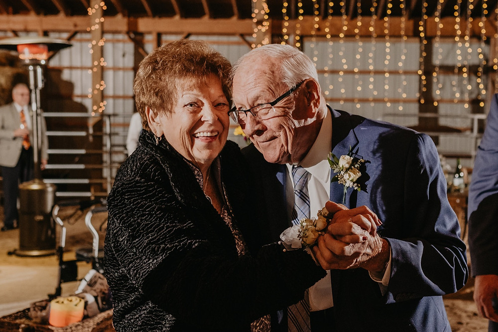 Family members dancing at rustic barn wedding. Photographed by Nicole Leanne Photography.