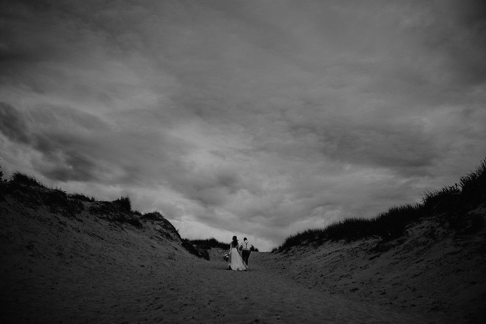 Sand dunes elopement in Northern Michigan. Photographed by Nicole Leanne Photography.