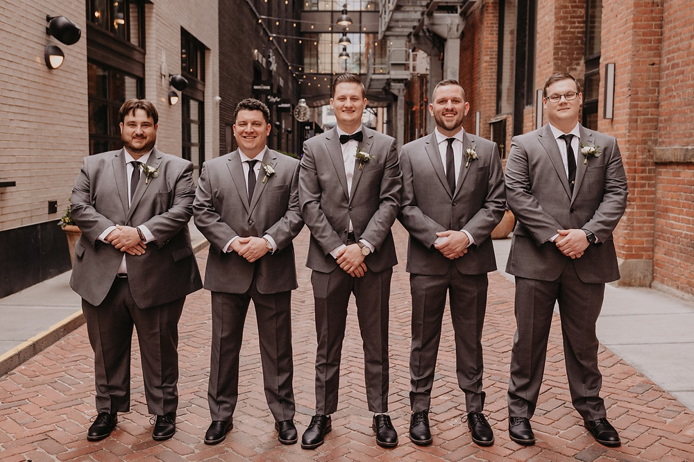 Groomsmen and groom in Shinola Alley in Detroit Michigan. Photographed by Nicole Leanne Photography.