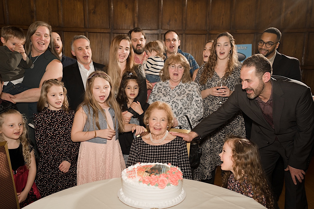 Family singing happy birthday to grandma. Photographed by Nicole Leanne Photography.