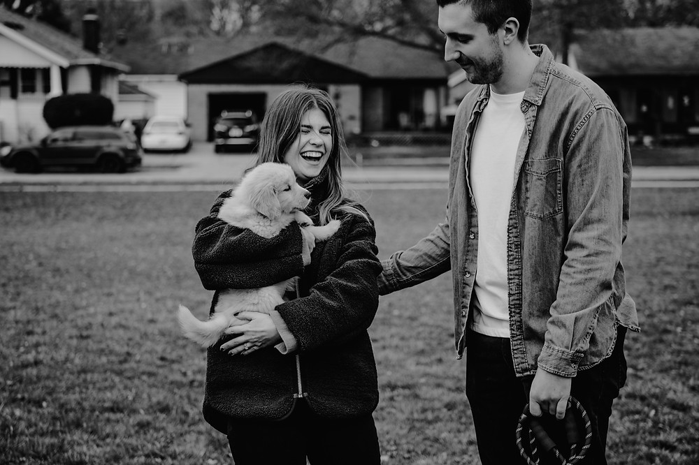 Black and white of family at park with puppy. Photographed by Nicole Leanne Photography