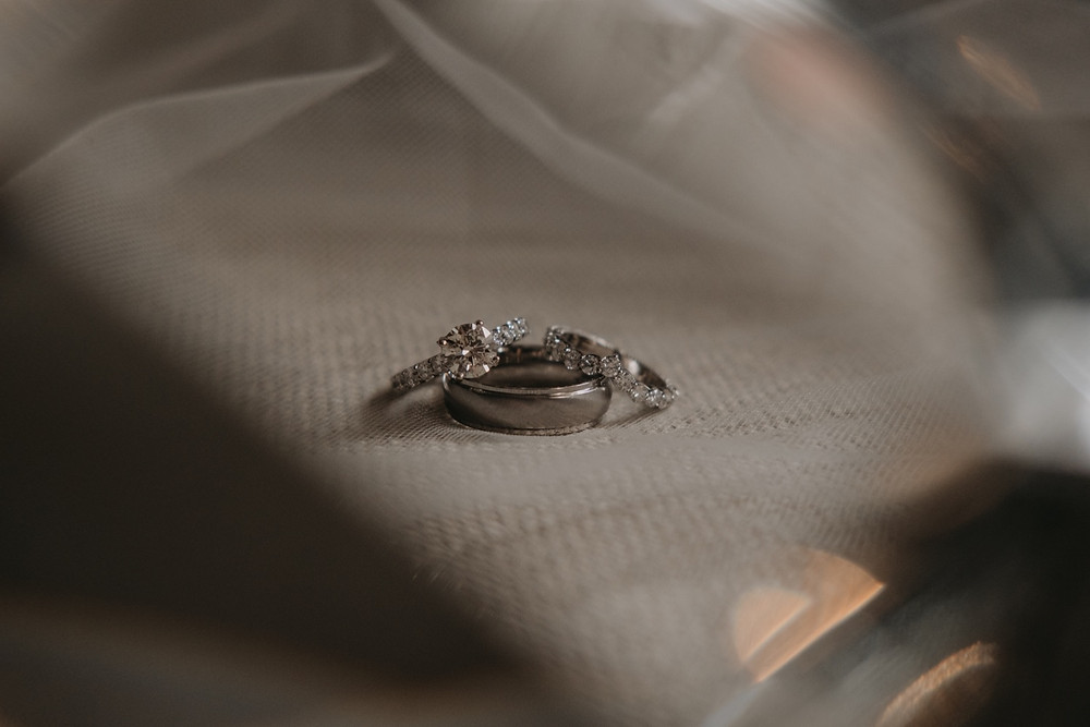 Wedding ring with veil detail shot. Photographed by Nicole Leanne Photography.