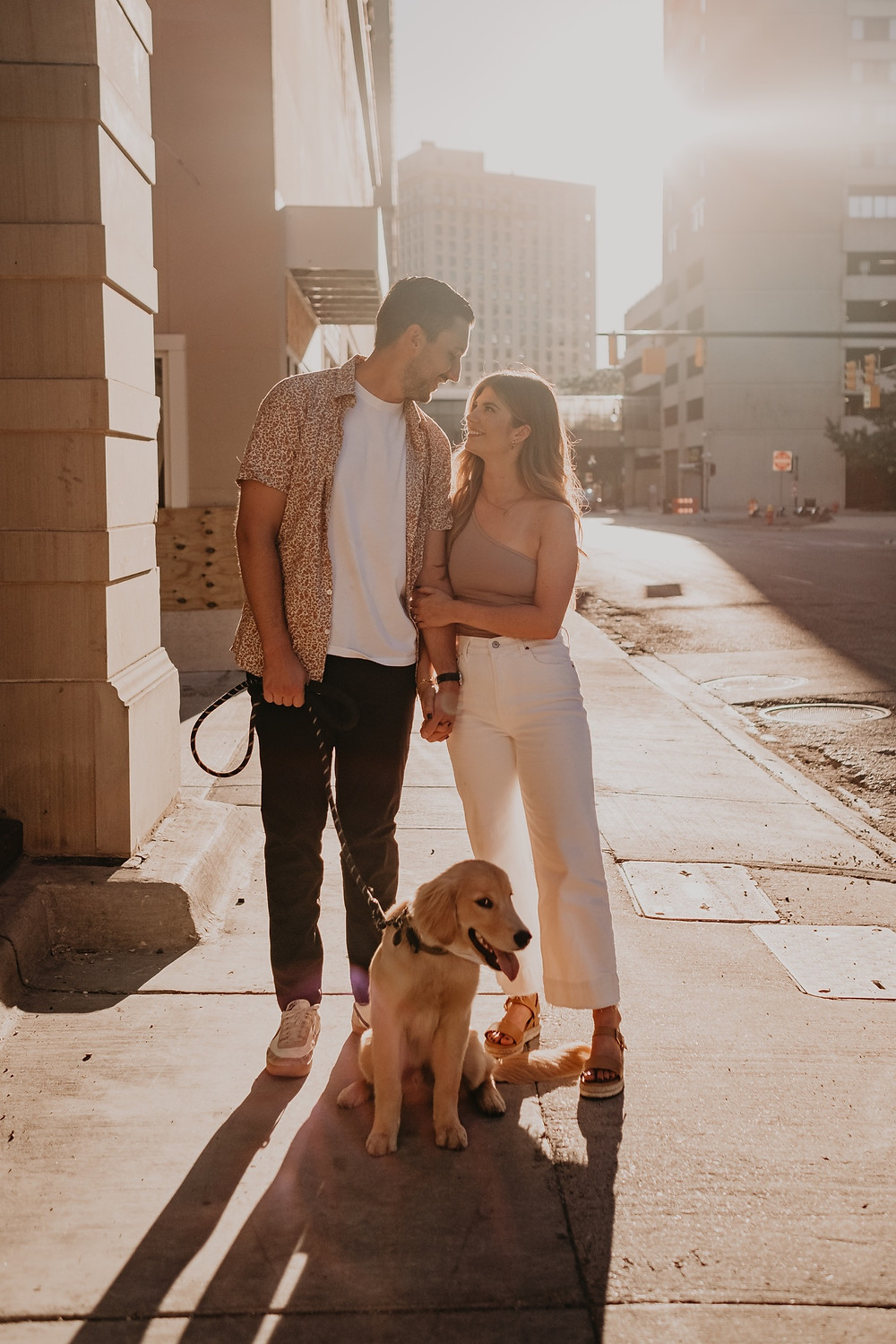 Sunset engagement session in Downtown Detroit with dog. Photographed by Nicole Leanne Photography.