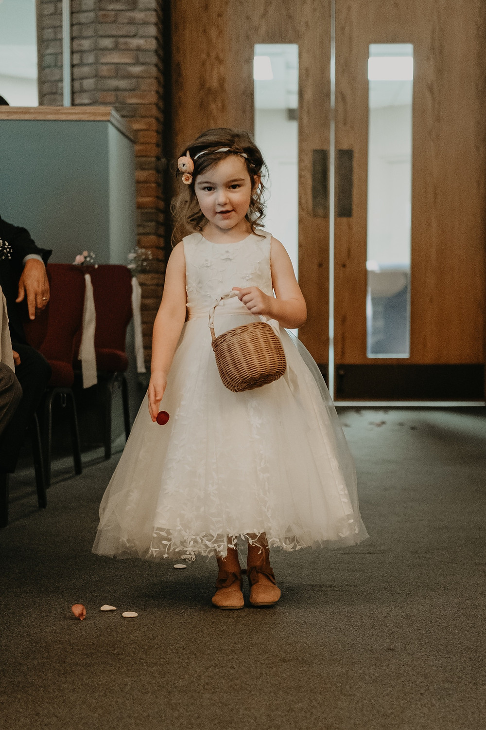Flower girl at church wedding. Photographed by Nicole Leanne Photography.