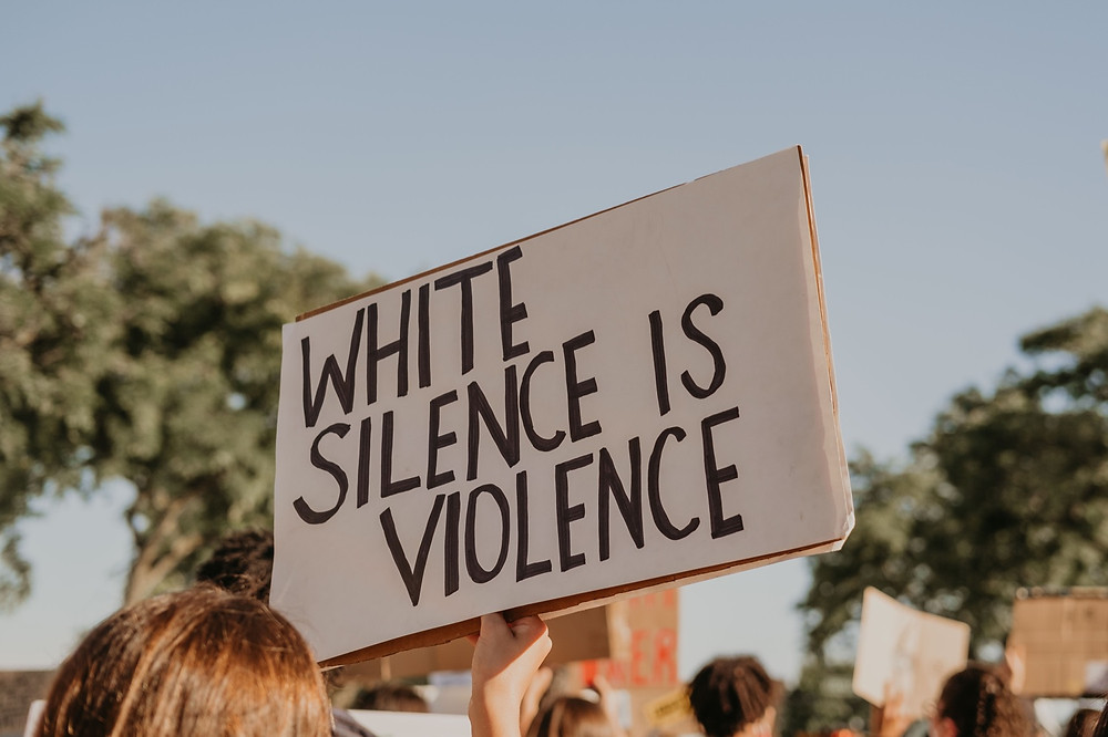 White silence is violence protest sign in 2020 Berkley Michigan protest