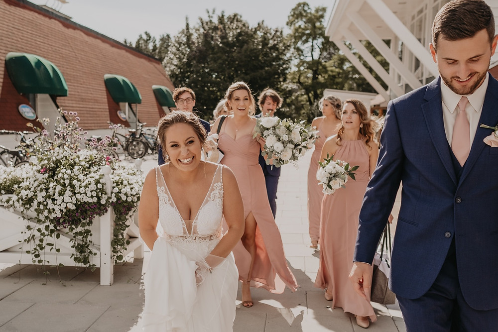 Summer wedding in Mackinac Michgan. Photographed by Nicole Leanne Photography.