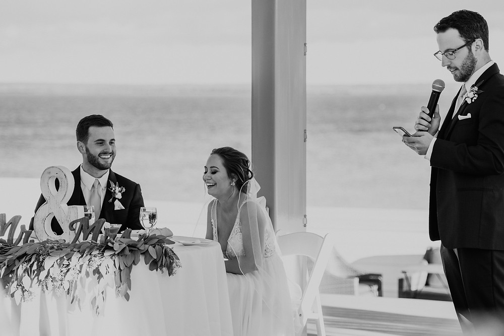 Wedding toasts at Mission Point Resort. Photographed by Nicole Leanne Photography.