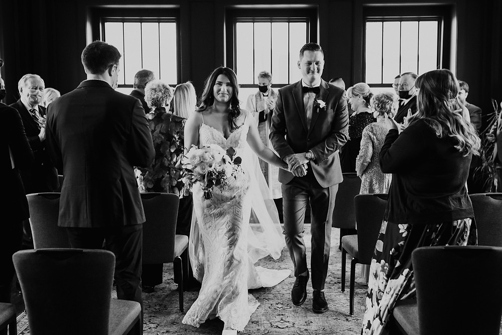 Black and white wedding photos at Detroit ceremony. Photographed by Nicole Leanne Photography.