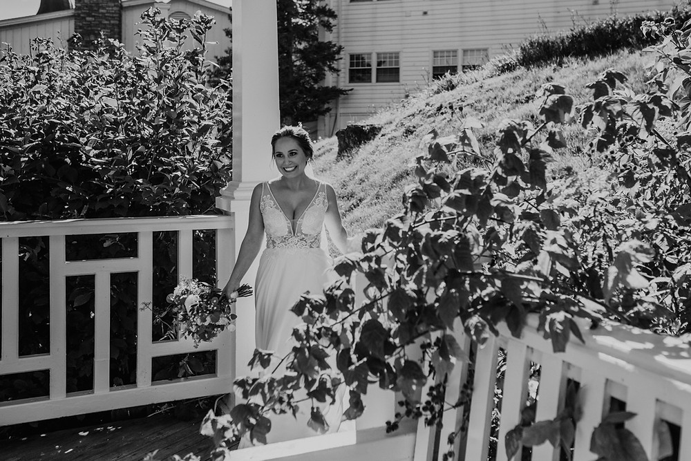 Bride walking in Mission Point Resort in Mackinac. Photographed by Nicole Leanne Photography.