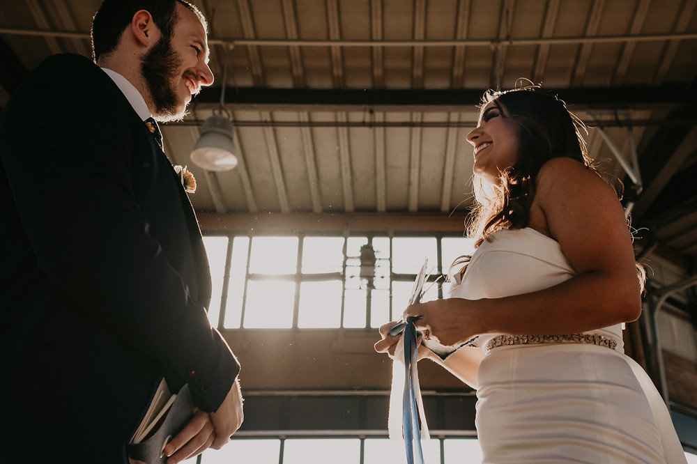 Industrial wedding photos at Eastern Market. Photographed by Nicole Leanne Photography.