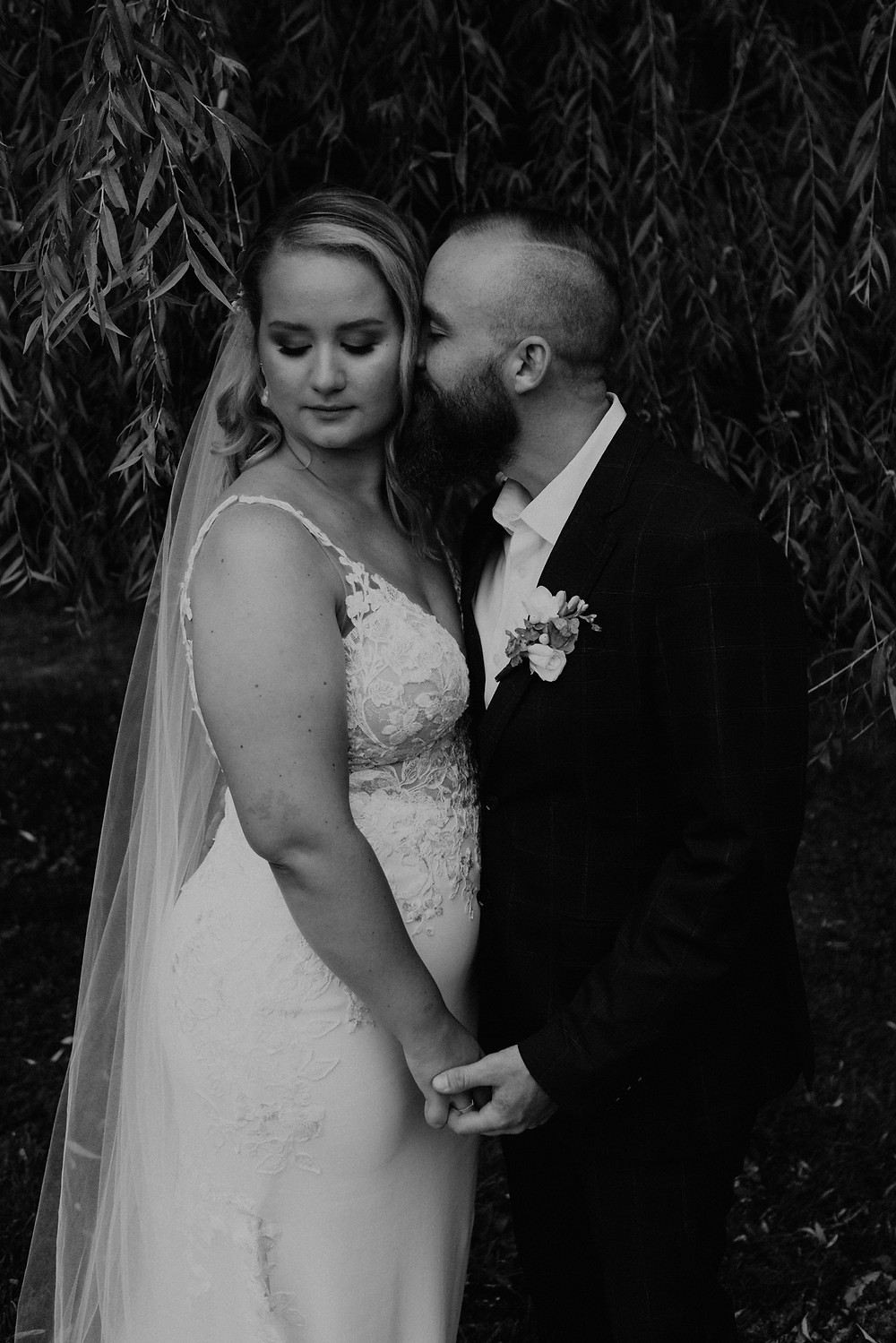 Black and white bridal portrait with bride and groom. Photographed by Nicole Leanne Photography.
