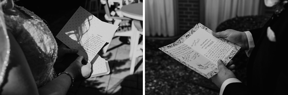 Bride and groom reading letters from each other. Photographed by Nicole Leanne Photography.
