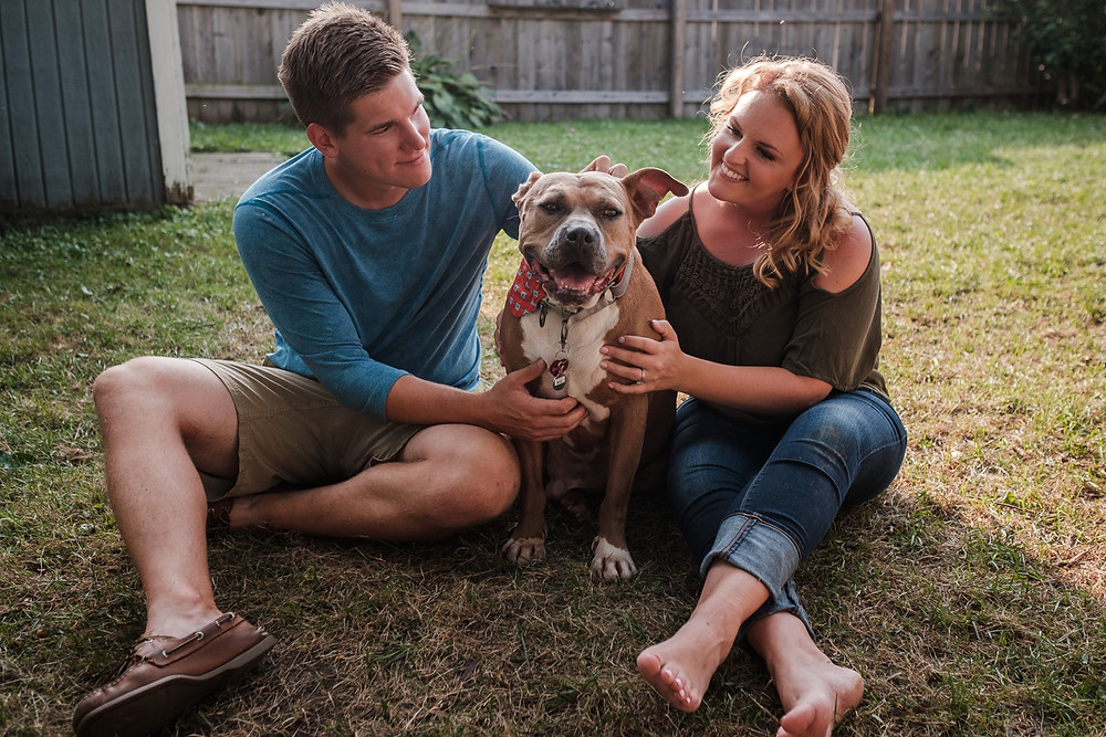 couple with dog, st. claire shores engagement session