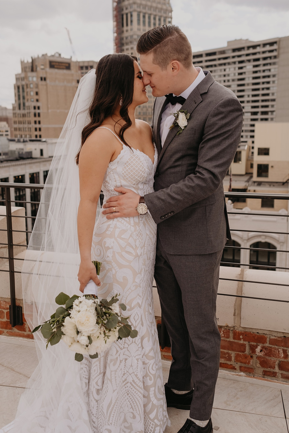 Bride and groom wedding day photo in Detroit. Photographed by Nicole Leanne Photography.