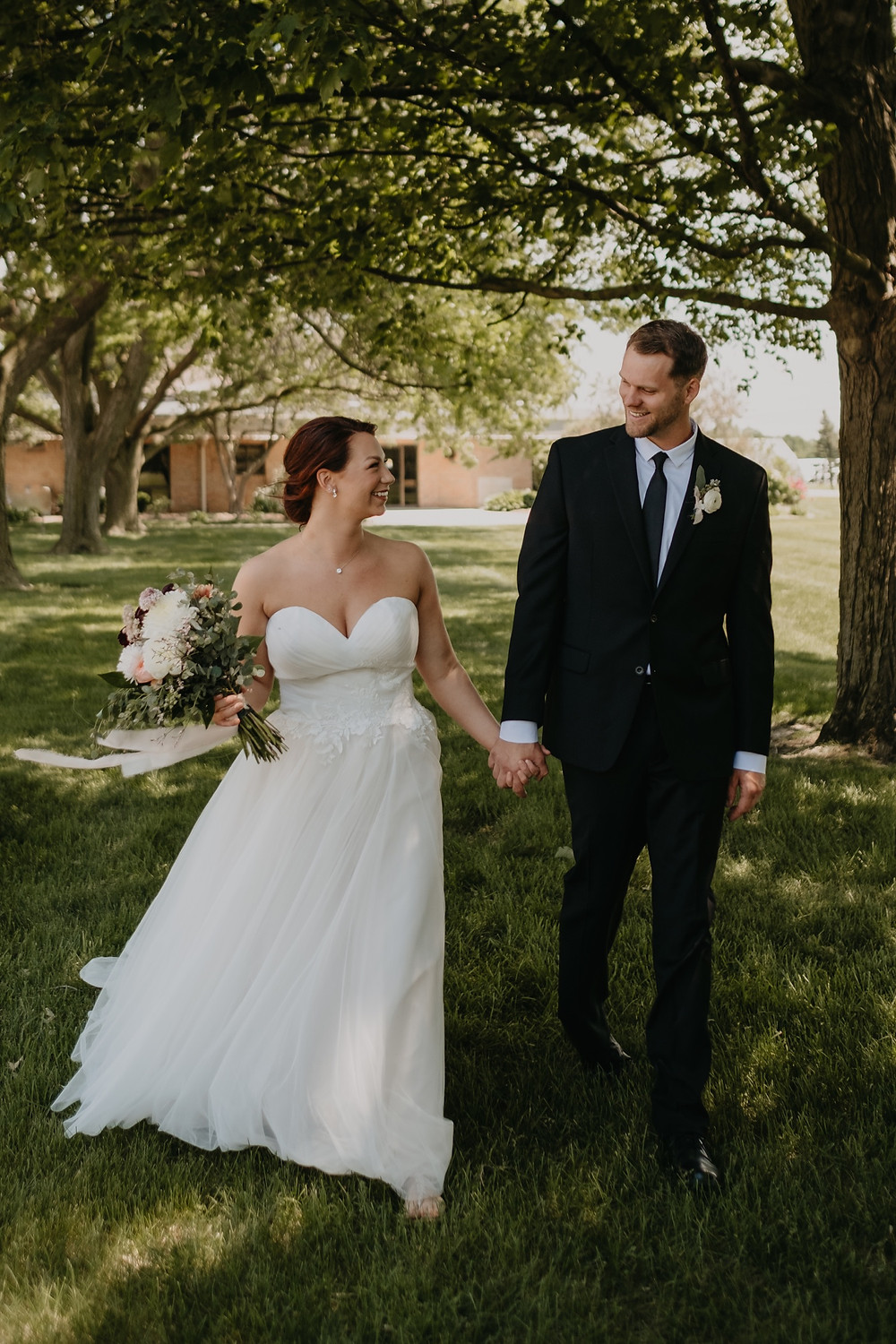 Bride and groom wedding portraits in Metro Detroit. Photographed by Nicole Leanne Photography.
