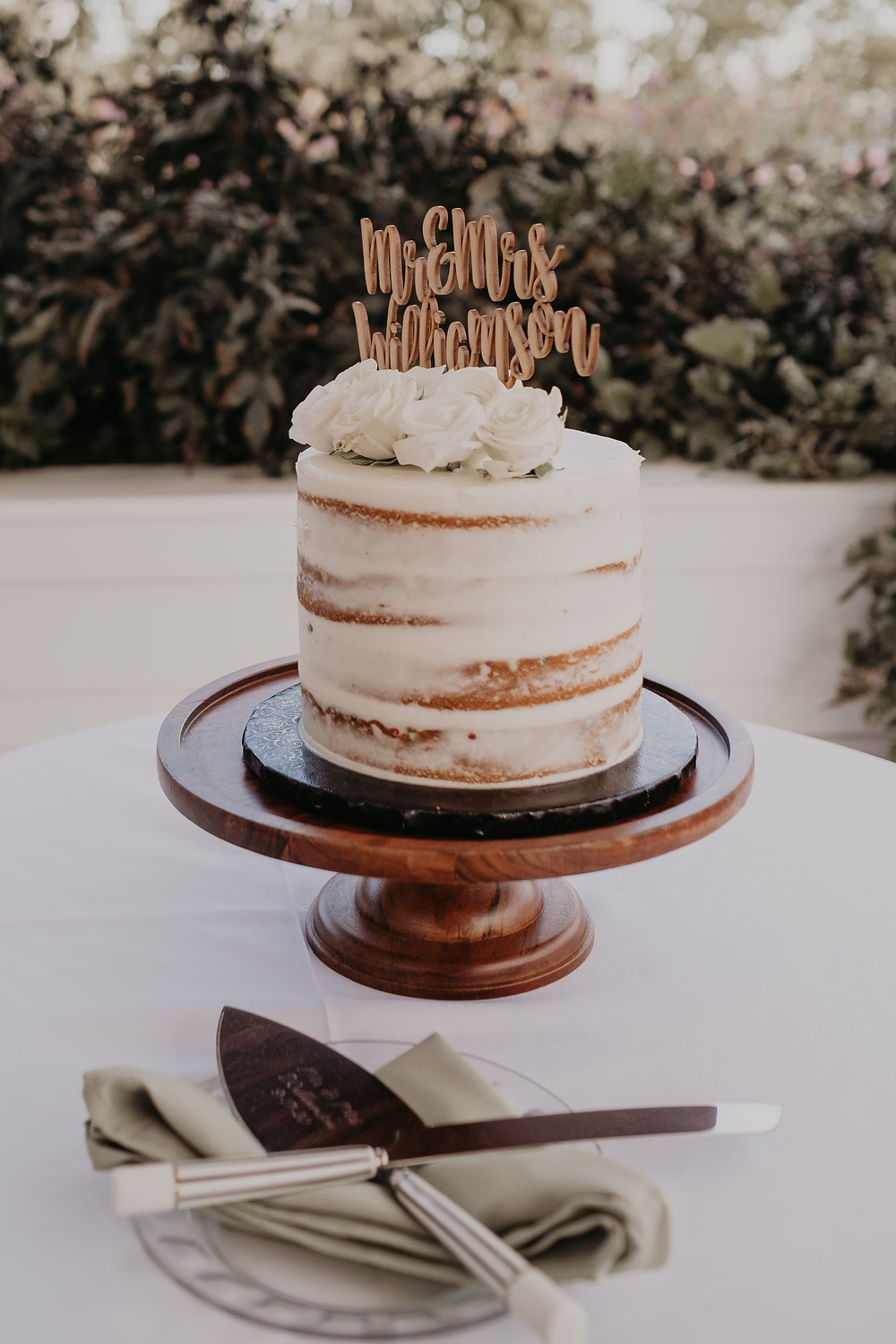 Wedding cake with serving utensils. Photographed by Nicole Leanne Photography.
