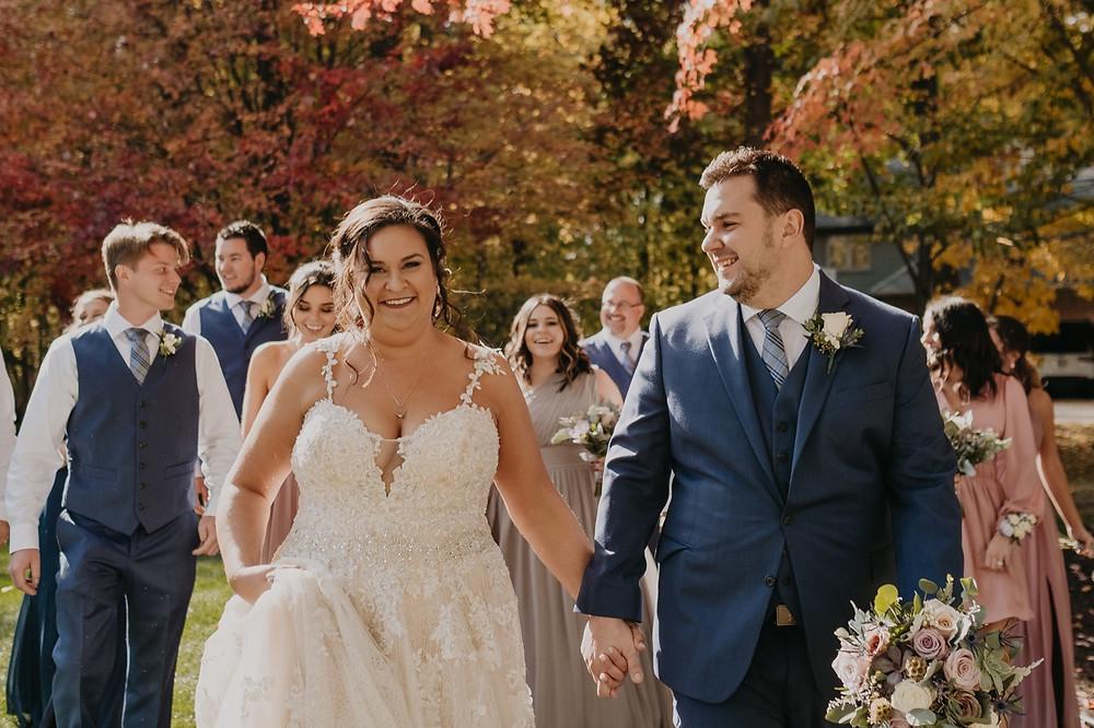 Michigan bride and groom with bridal party at fall barn wedding