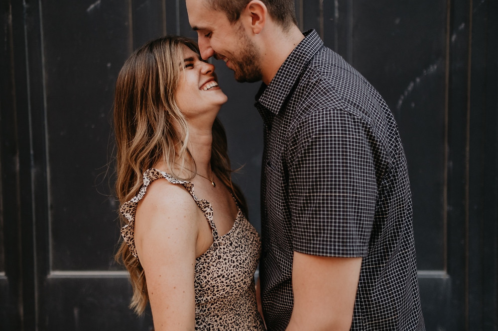 Cute and casual engaged couple in Detroit. Photographed by Nicole Leanne Photography.
