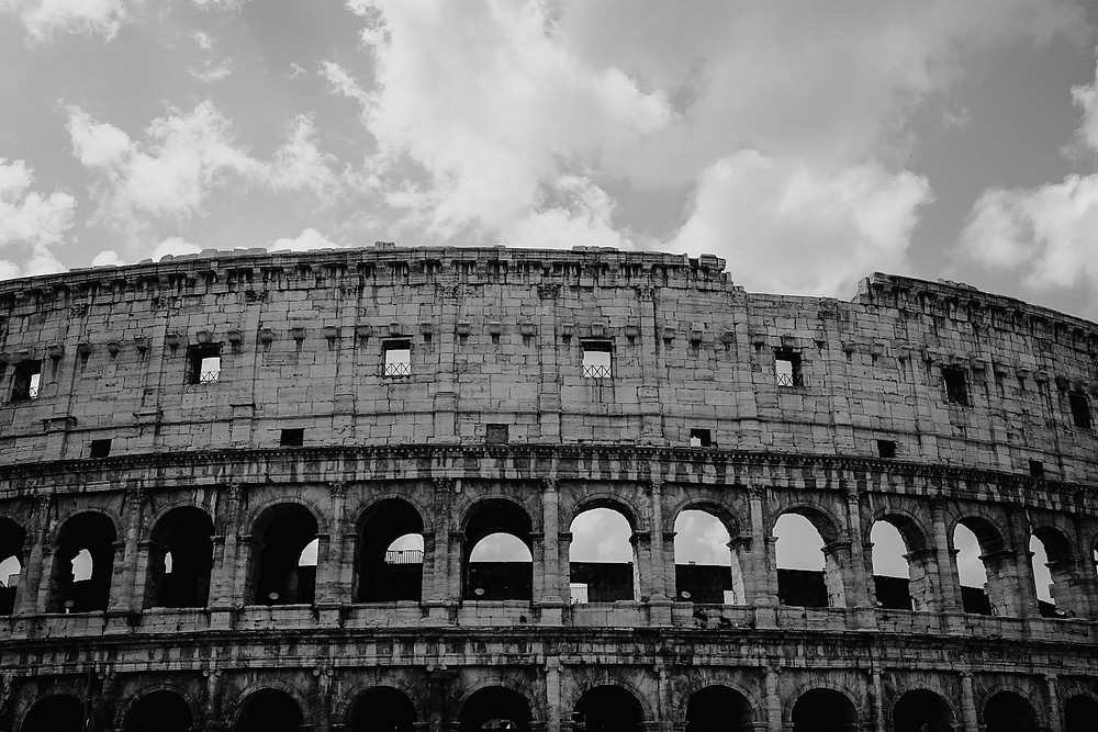 Roman Colosseum in black and white. Photographed by Nicole Leanne Photography.