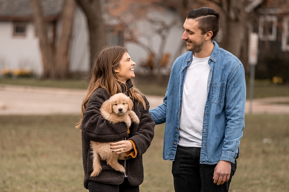 Wedding proposal in Royal Oak Michigan with golden retriever puppy. Photographed by Nicole Leanne Photography