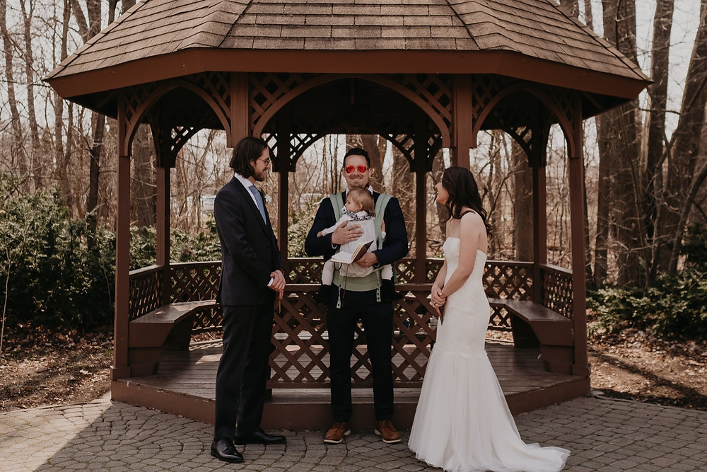 Bride and groom at Heritage Park wedding under gazebo. Photographed by Nicole Leanne Photography.