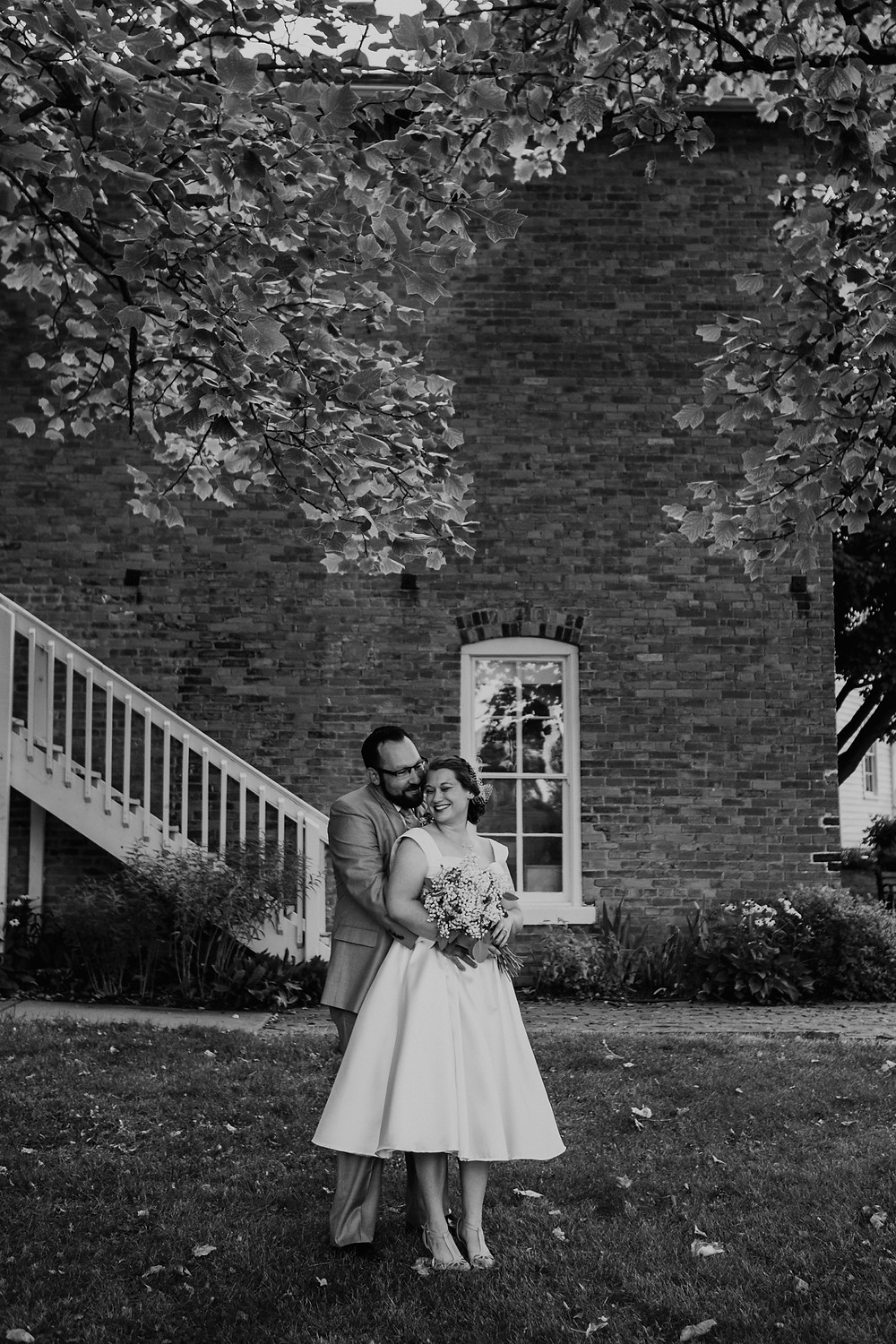 Black and white of bride and groom at Meridian Historical Village. Photographed by Nicole Leanne Photography.