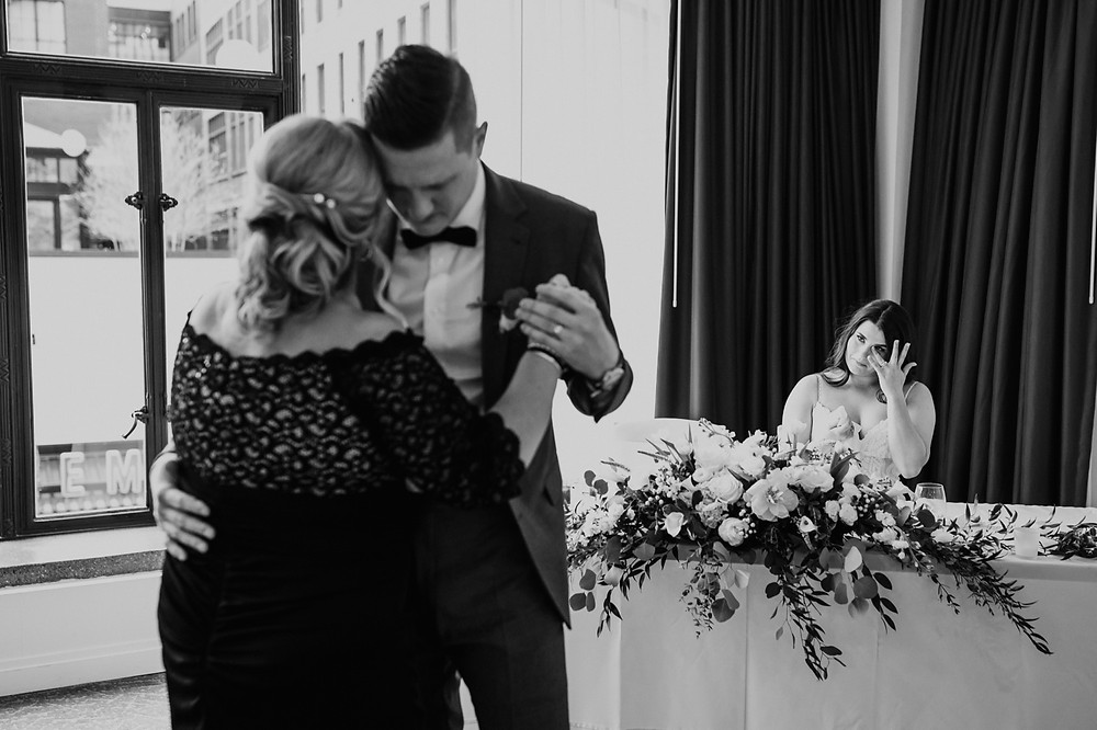 Groom and mother dance at wedding together