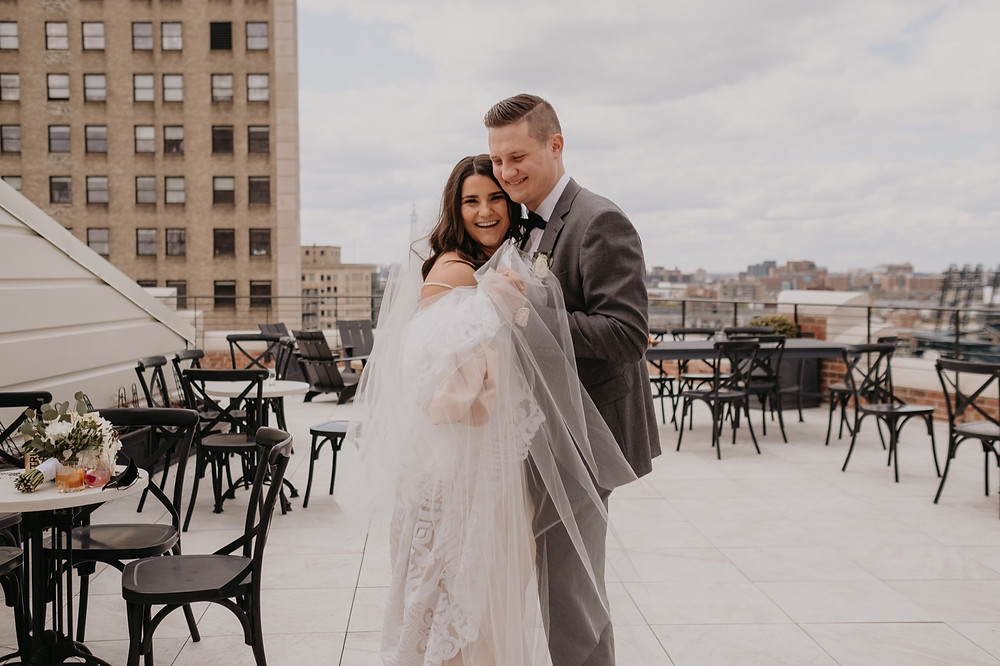 Bride and groom rooftop wedding photos in Downtown Detroit. Photographed by Nicole Leanne Photography.