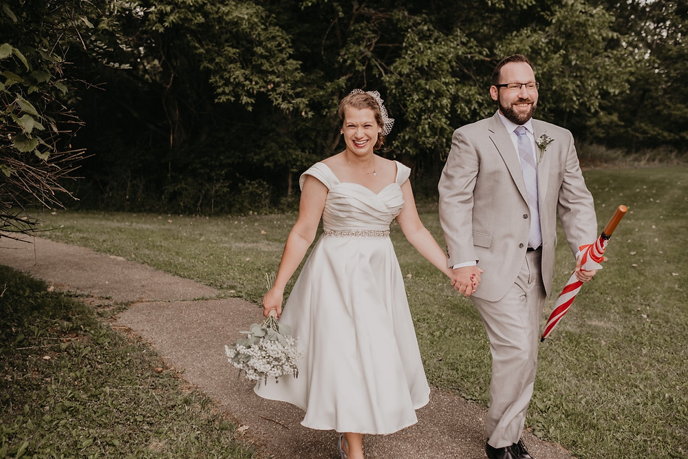 Couple walking at Meridian Historical Village after wedding ceremony. Photographed by Nicole Leanne Photography.