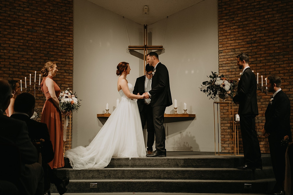 Wedding ceremony at Metro Detroit church. Photographed by Nicole Leanne Photography.
