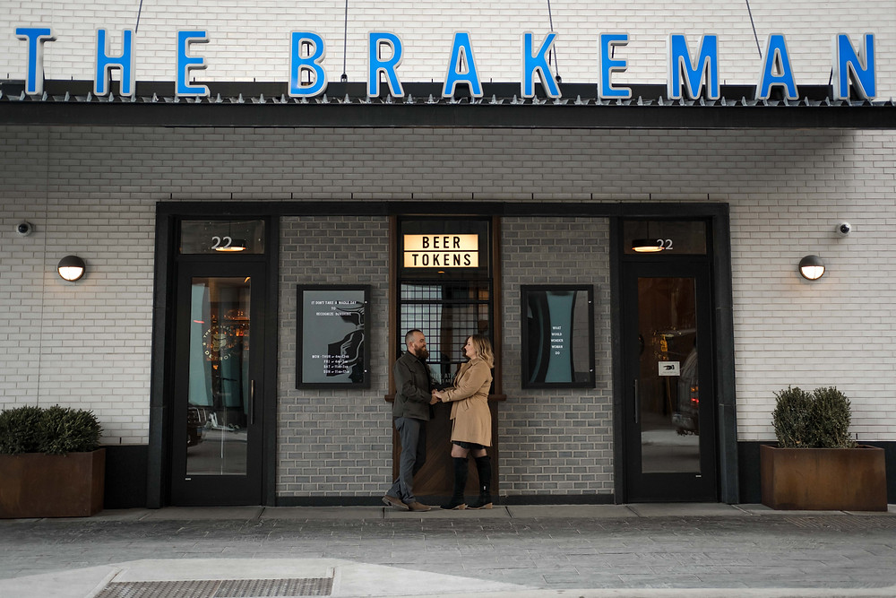 Couple outside The Brakeman for engagement photos. Photography by Nicole Leanne Photography