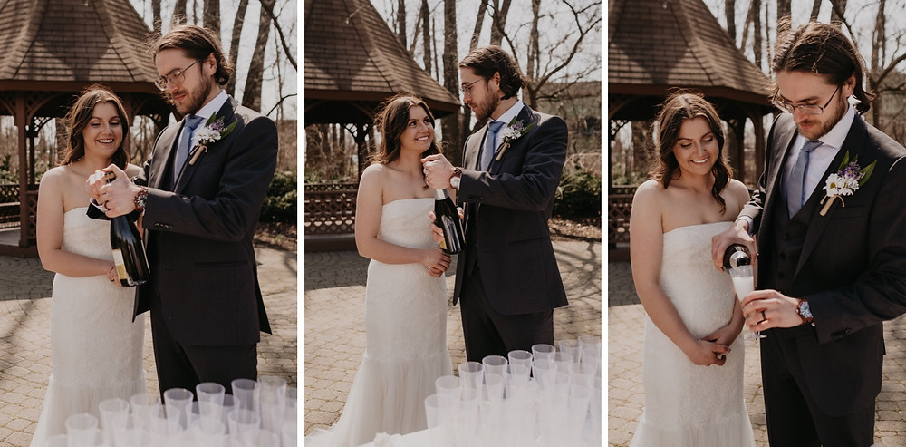 Bride and groom popping champagne for wedding guests.