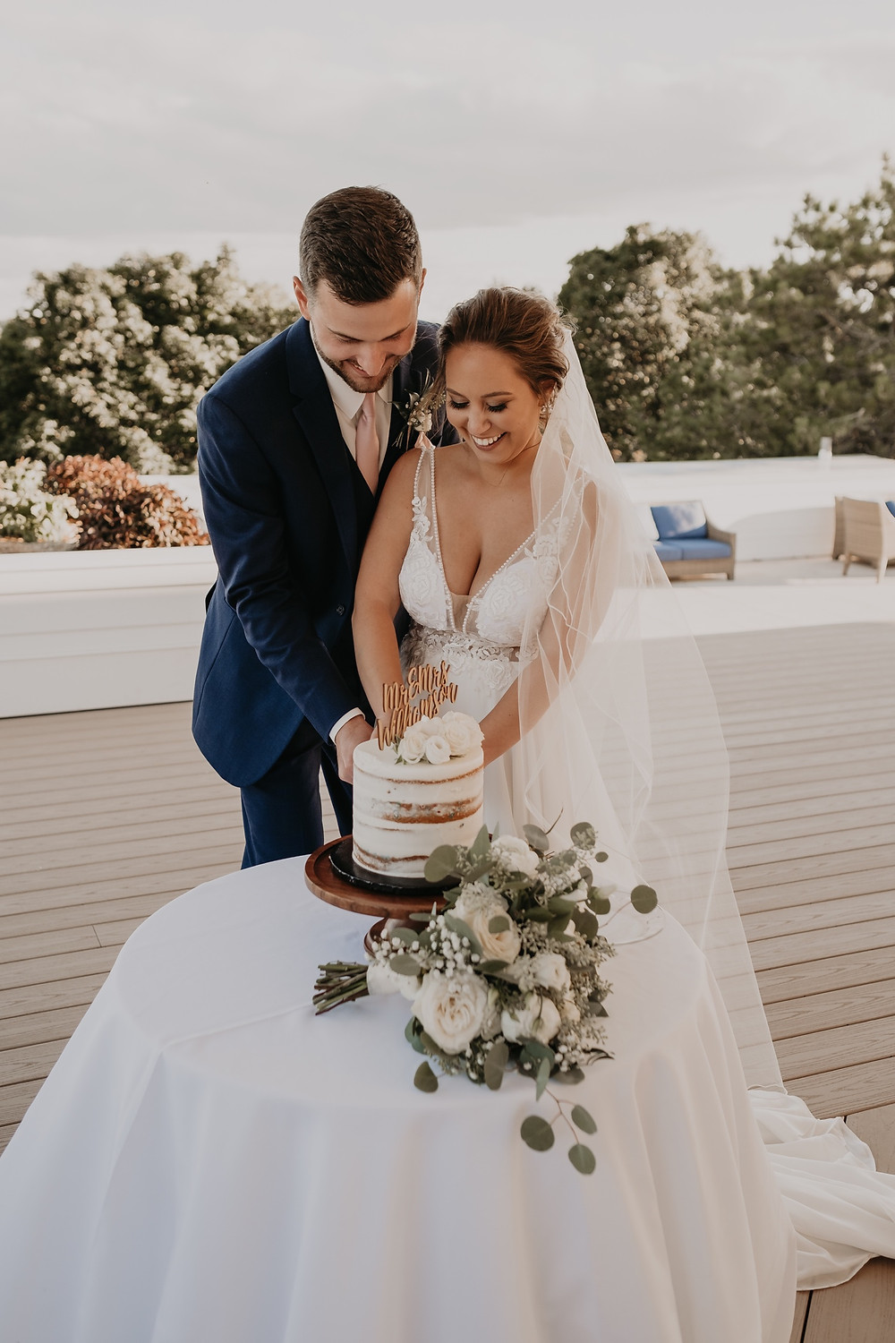 Bride and groom cutting cake. Photographed by Nicole Leanne Photography.