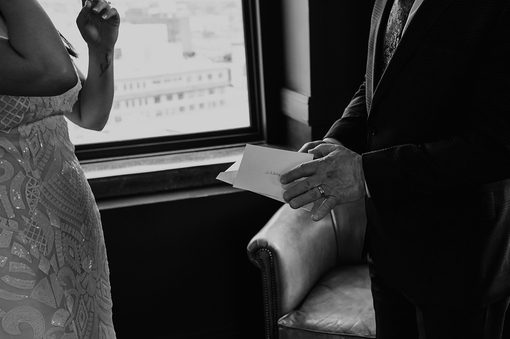 Father of the bride reading letter. Photographed by Nicole Leanne Photography.