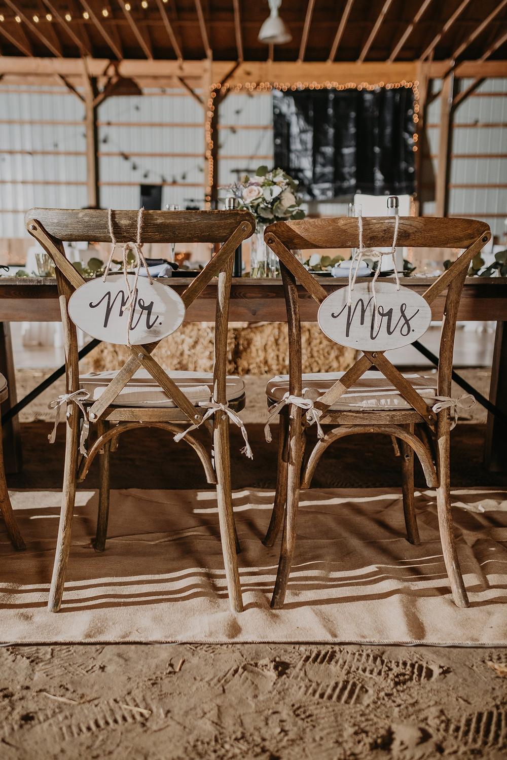 Michigan barn wedding bride and groom chair signs
