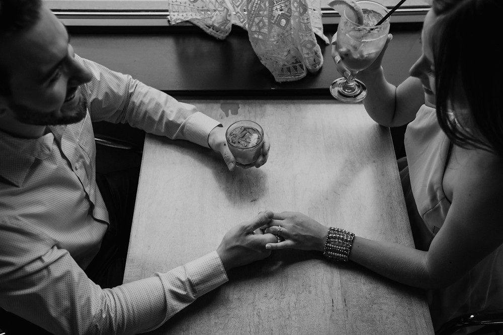 Overhead photo of couple at a bar. Photographed by Nicole Leanne Photography.