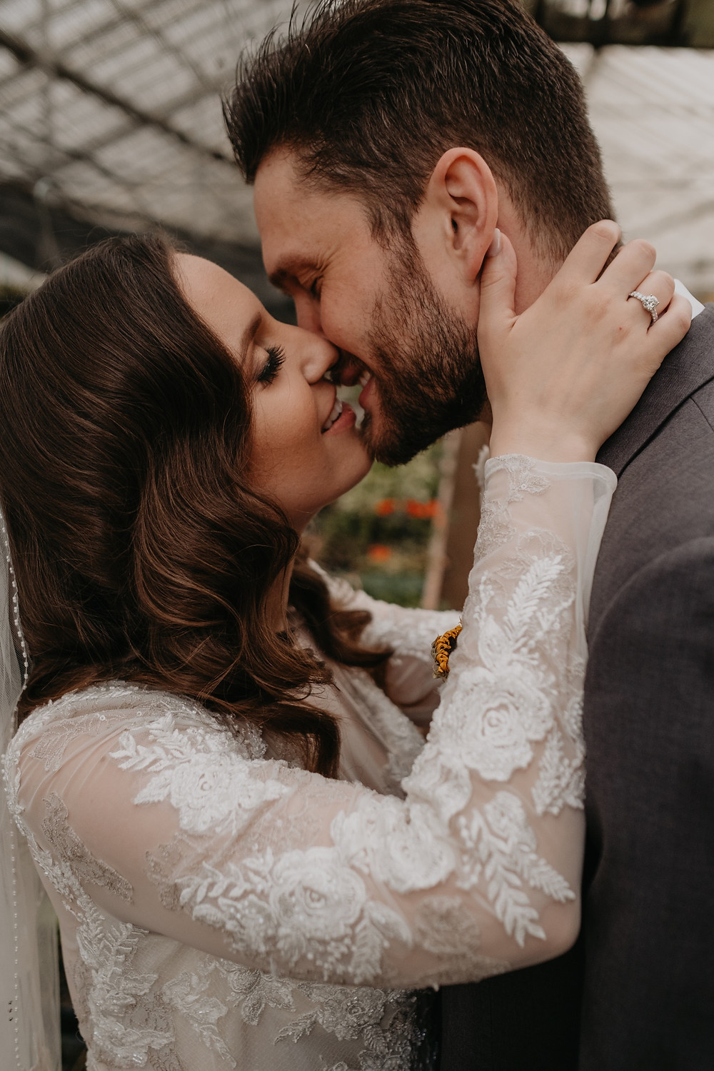 Wedding day kiss with bride and groom. Photographed by Nicole Leanne Photography.
