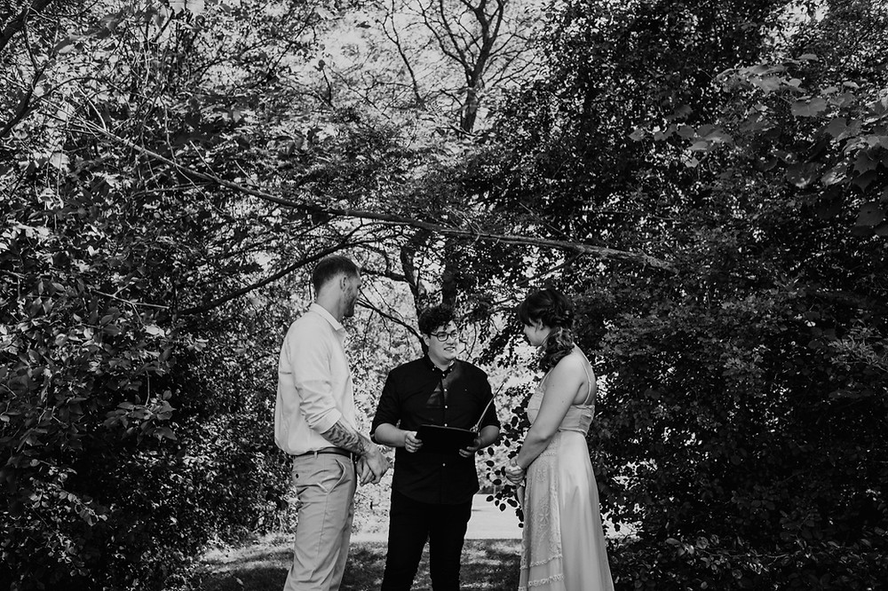 Black and white park wedding ceremony. Photographed by Nicole Leanne Photography.