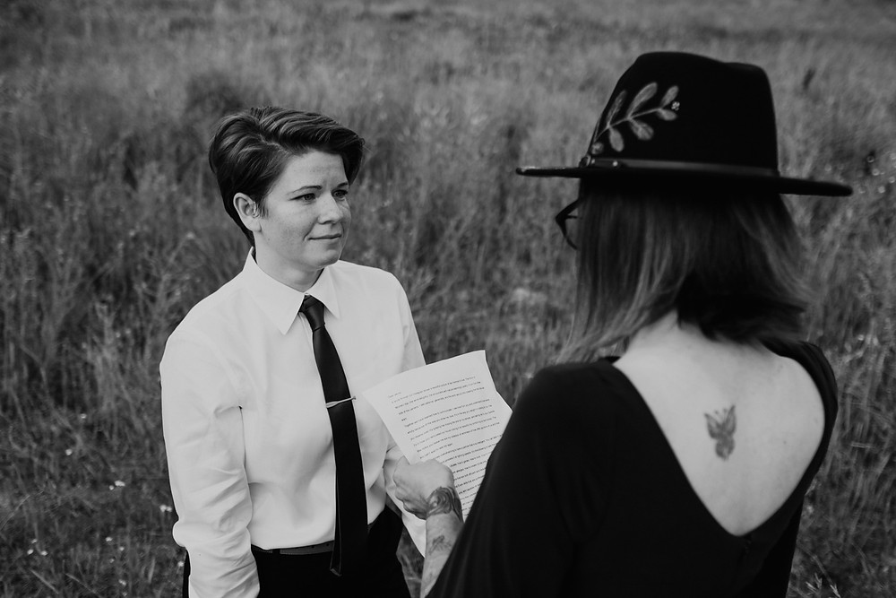 Black and white photo of couple during commitment ceremony. Photographed by Nicole Leanne Photography