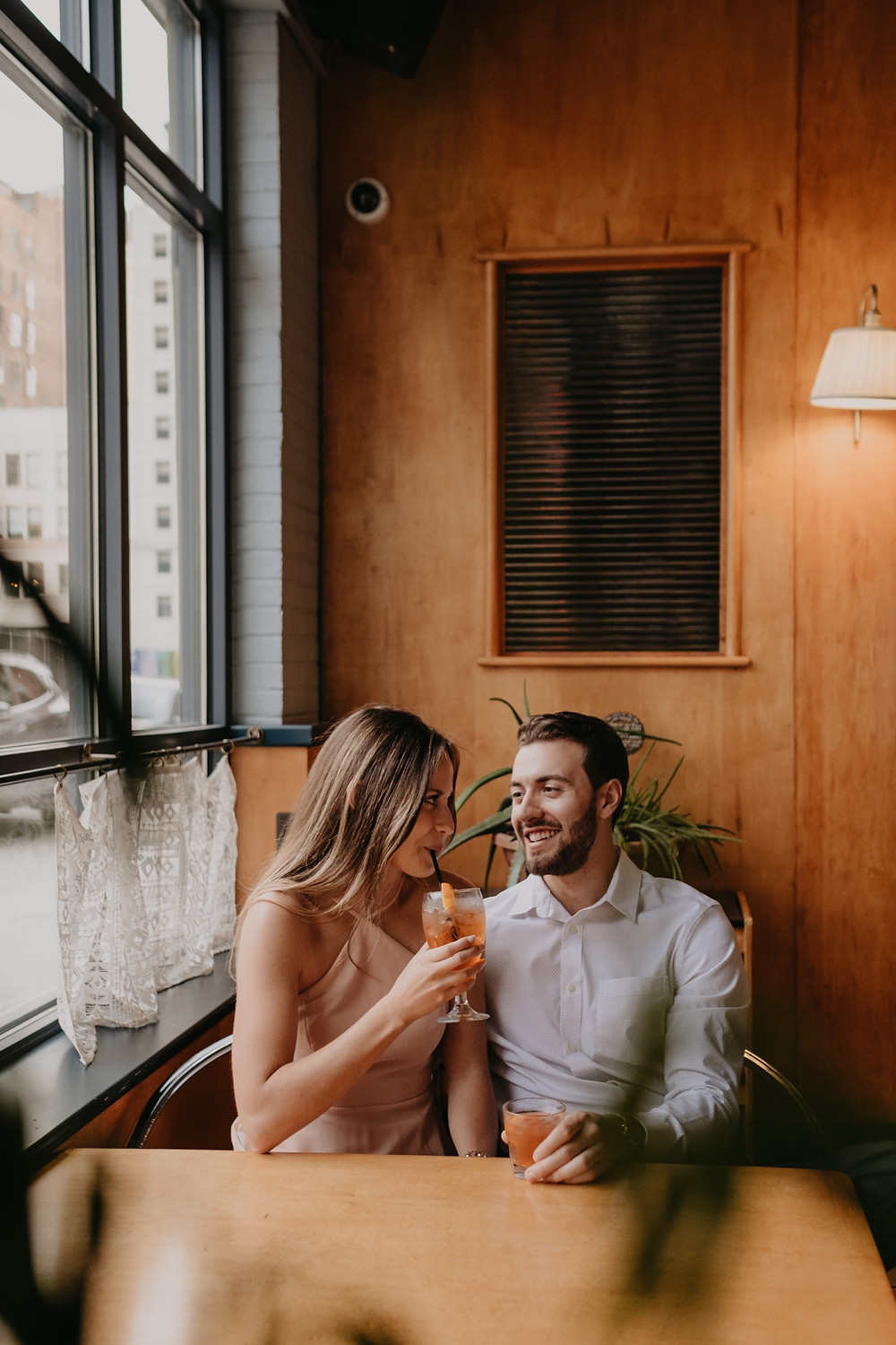 Couple enjoying drinks at bar in Detroit. Photographed by Nicole Leanne Photography.