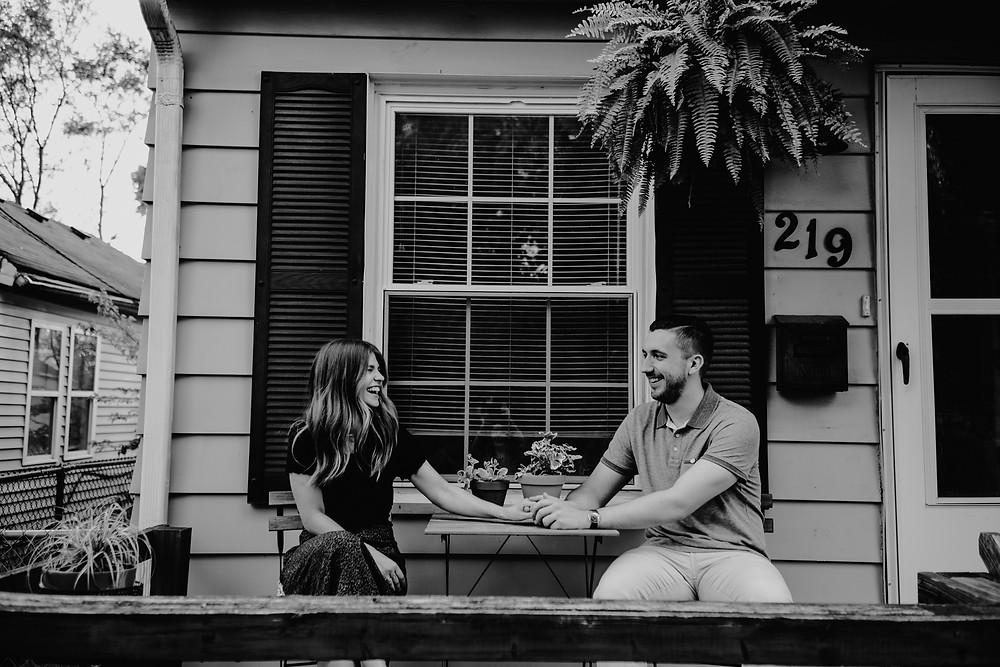 Couple sitting on porch at Metro Detroit home. Photographed by Nicole Leanne Photography.