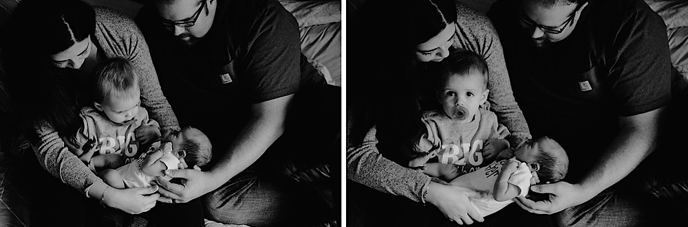 black and white family portrait in bed