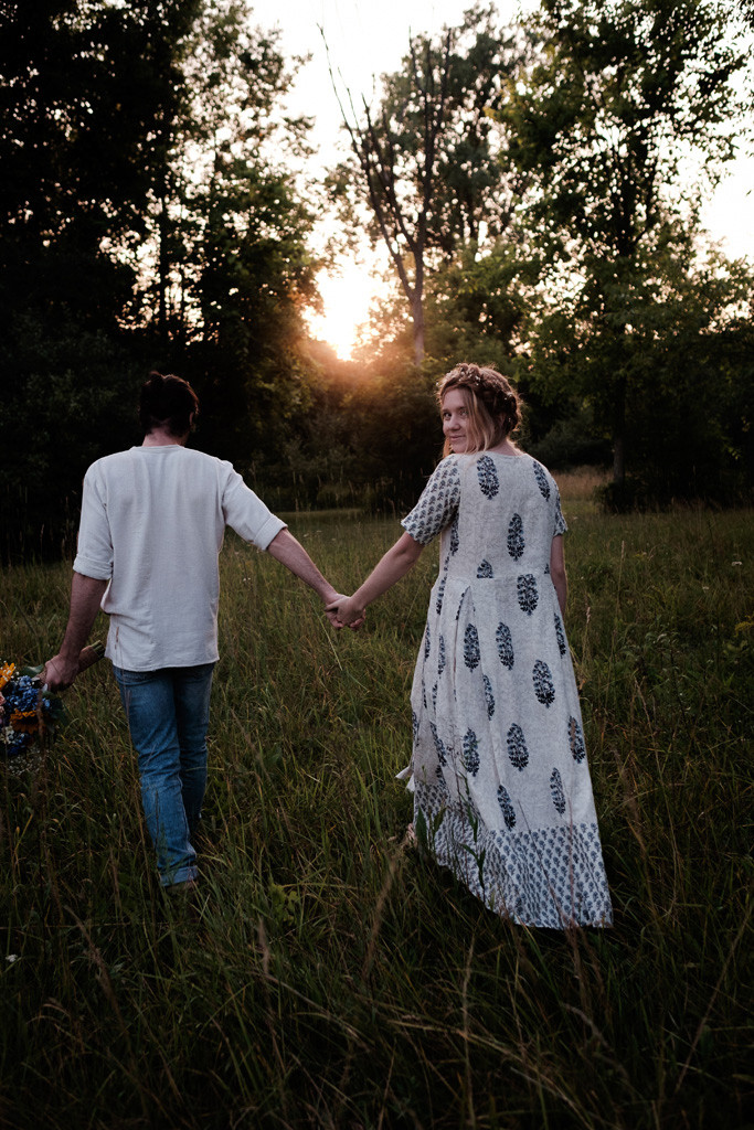walking in the grass, holding hands