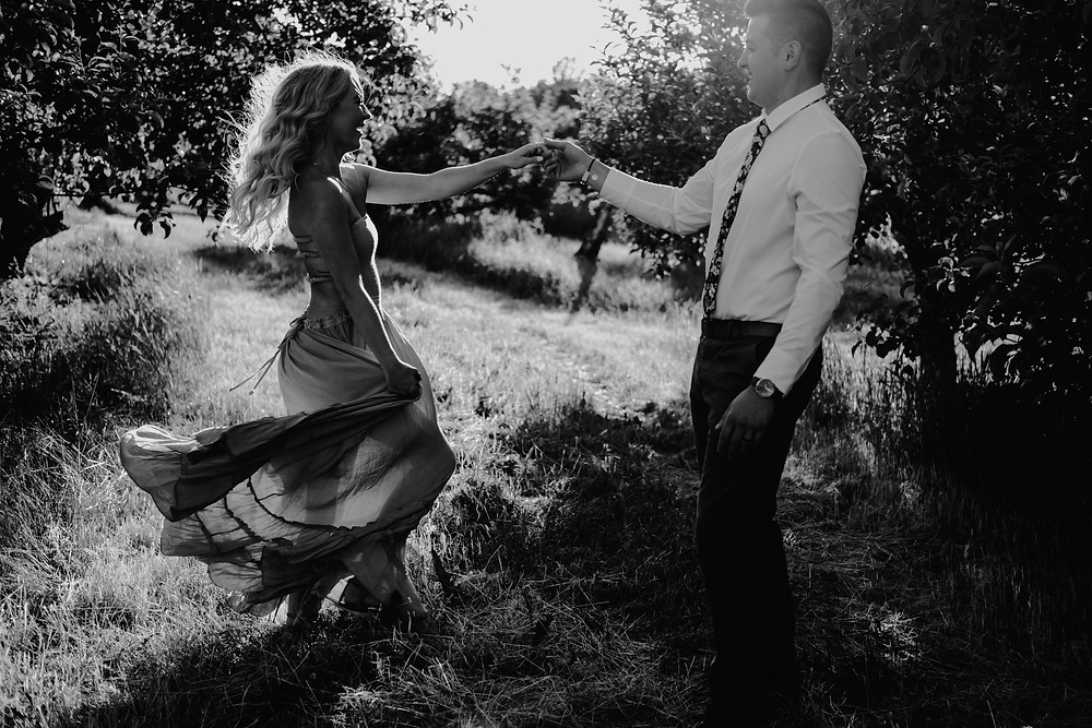 Detroit couple dancing during engagement photos in Traverse City, Michigan