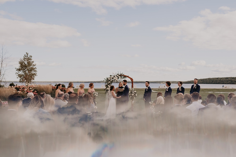 Wedding ceremony at Mission Point Resort. Photographed by Nicole Leanne Photography.